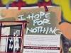 """Wandbild in der Einkaufsstraße Ermou – Detail 2 – """"I hope for nothing!"""""""